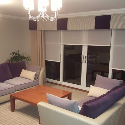 Extra-wide width pelmet over curtains and roller blinds on balcony window