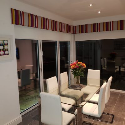 Pelmet board, with roller blinds underneath, in Camengo fabric