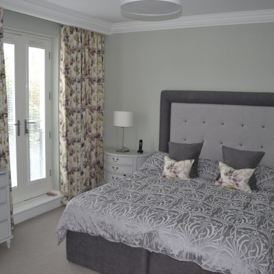 Padded headboard with border and buttons, and matching bed valance in Villa Nova Lille fabric