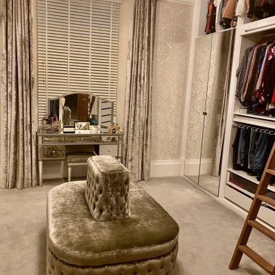 Seating for large dressing room designed in a oval shape with centre piece and buttoned in a Chesterfield style.